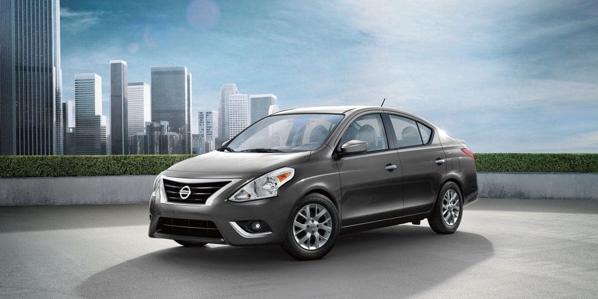 2019 Nissan Versa in front of city