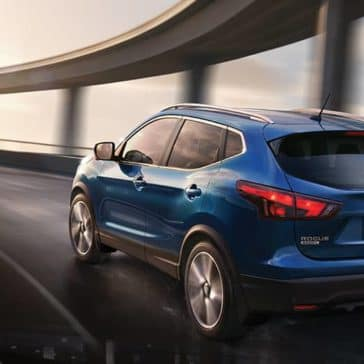 2019-Nissan-Rogue-Sport-rear-angle-driving-on-highway