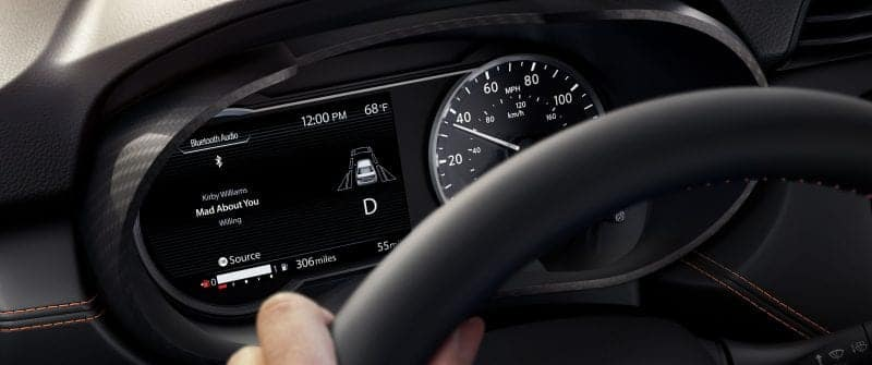 2019 Nissan driver hand on wheel with odometer