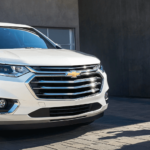 2020 Chevy traverse parked in driveway with children and mother