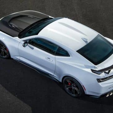 bird's-eye view of white 2018 Chevrolet Camaro with black hood