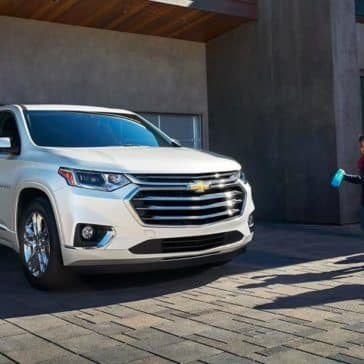 2019 Chevrolet Traverse parked in front of garage