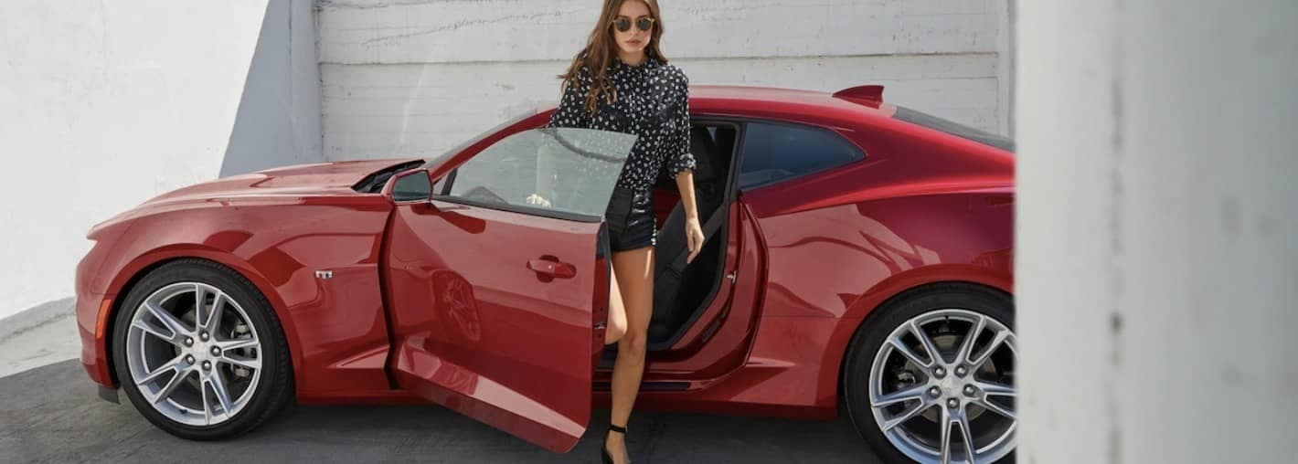 women steps out of 2019 Chevy Camaro 3LT