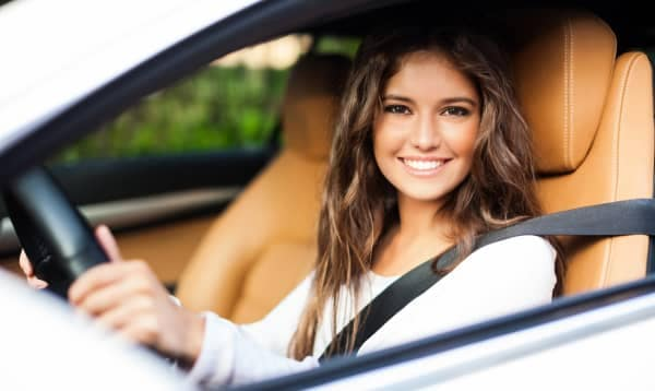 young woman in new car