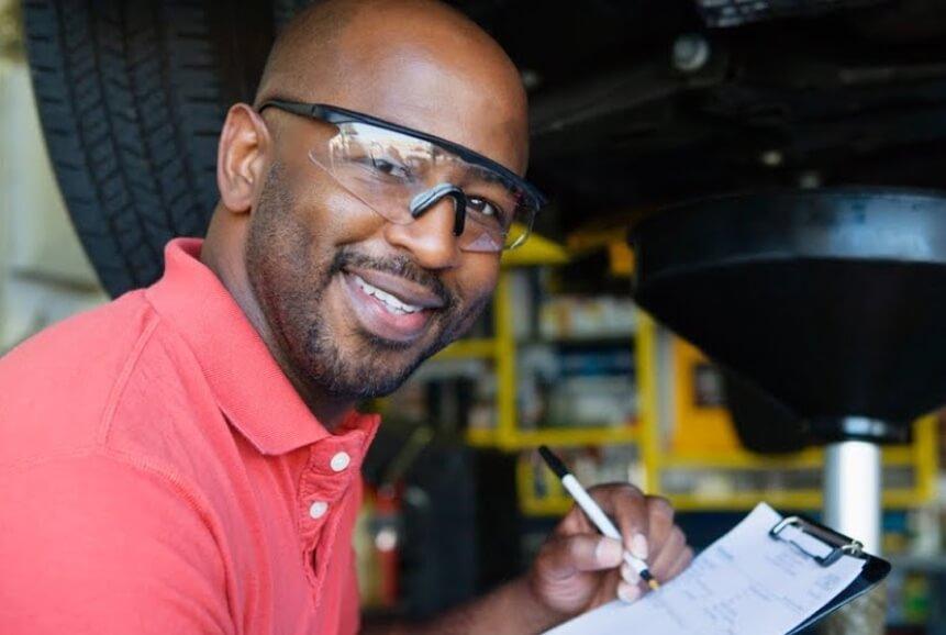 auto mechanic writing down information