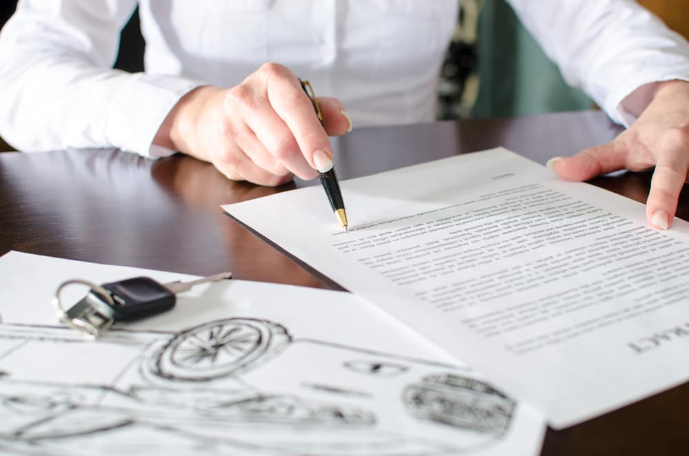 Woman reading a car purchase contract