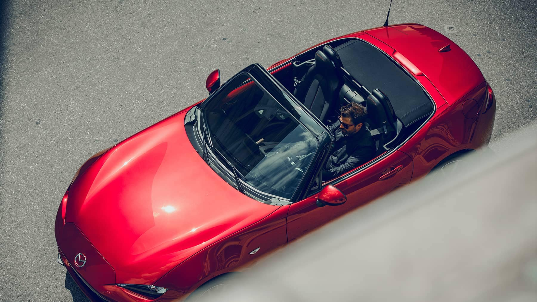 2019 Mazda MX-5 Miata parked with the top down
