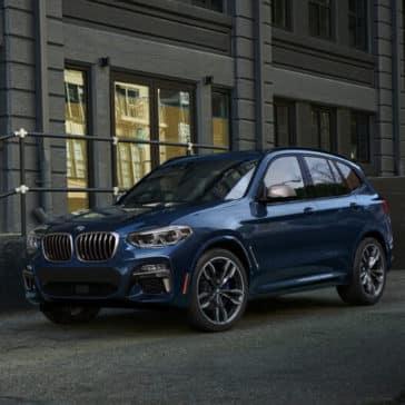 2018 BMW X3 M40i parked on city street