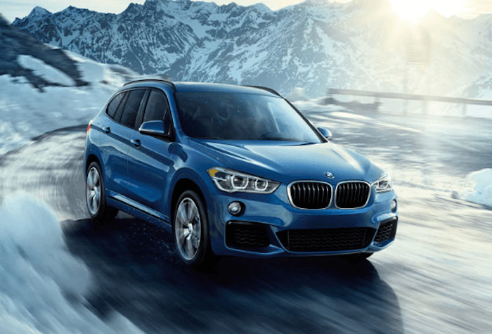 2019 BMW X1 blue SUV driving in snow