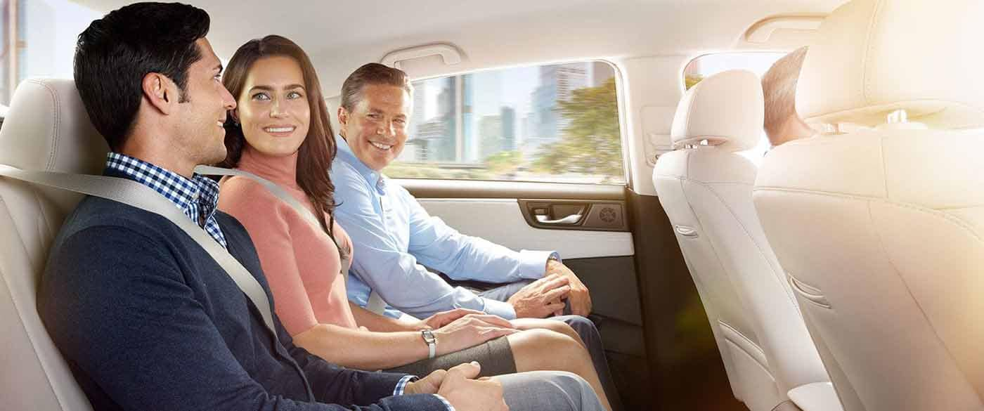 3 Adults sitting in the back of a 2018 Honda Clarity Plug In Hybrid
