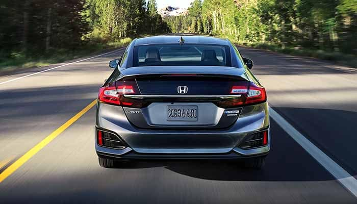 2018 Honda Clarity Plug In Hybrid driving down the road rear view