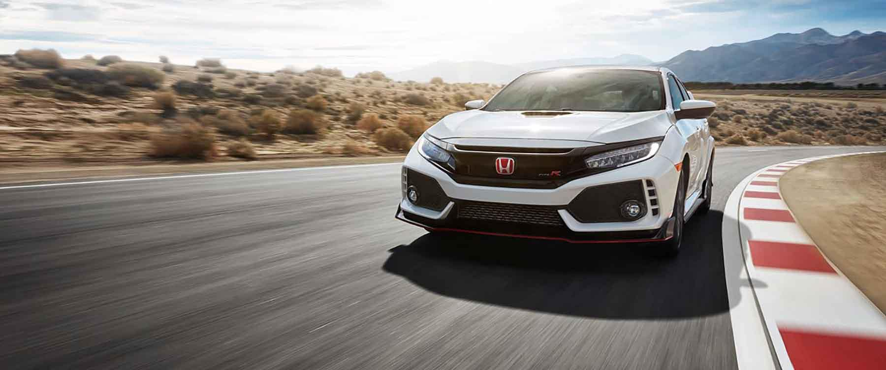 2018 Honda Civic Type R driving fast around a corner
