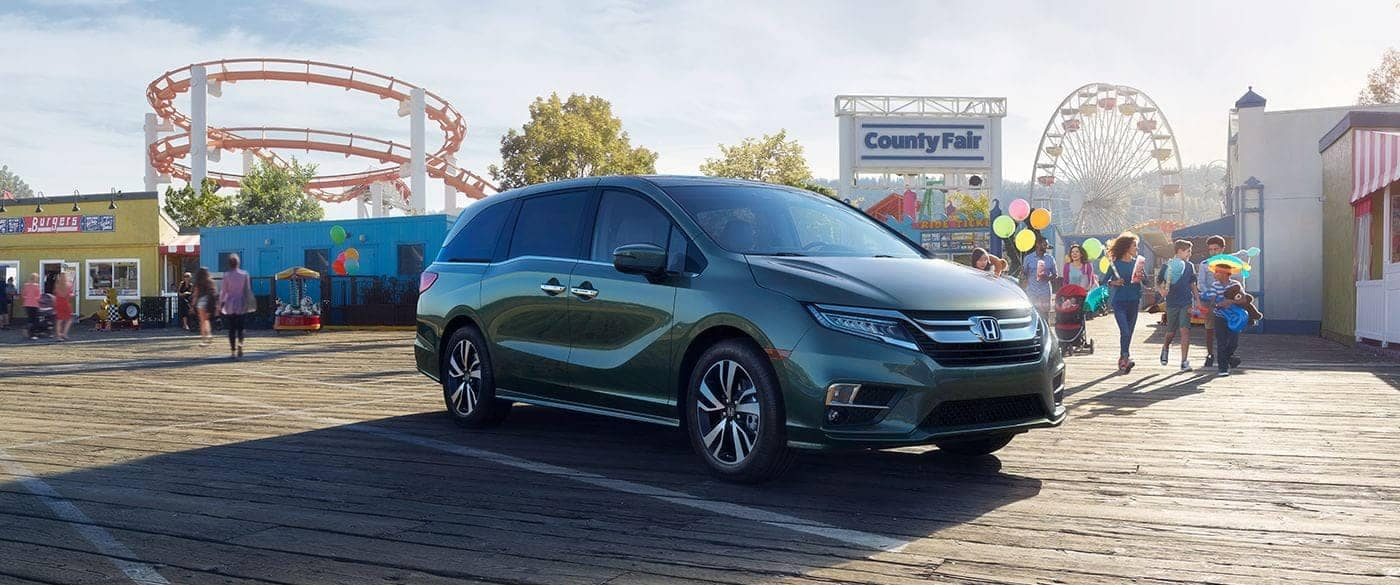 2018 Honda Odyssey parked in parking lot of amusement park