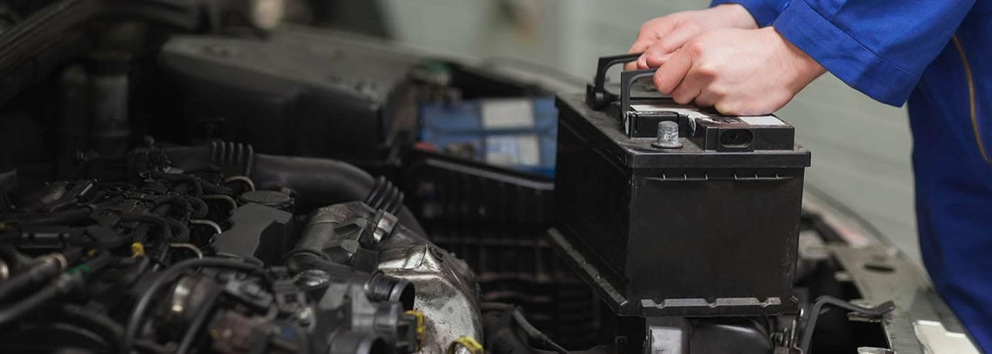 Mechanic charging car battery