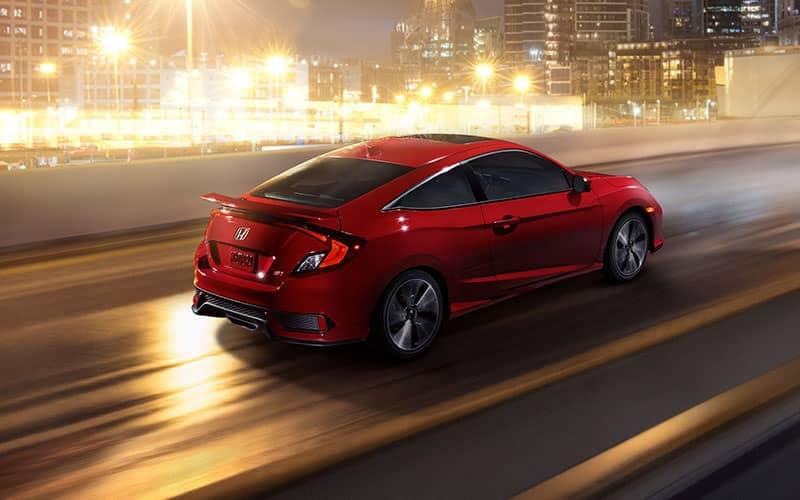 2018 Honda Civic Si Coupe Driving Down Highway at Night