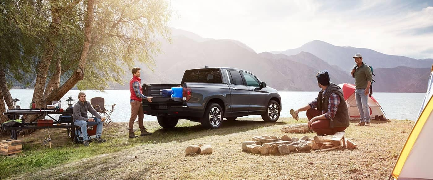 2019 Honda Ridgeline Parked at Campsite by a Lake and Mountains
