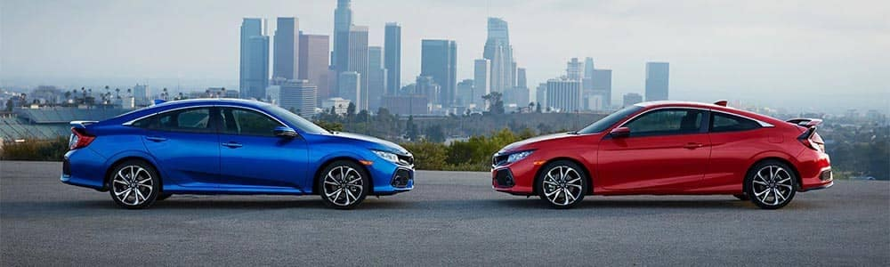 2019 Hond Civic Si Sedan and Coupe Models Parked in Front of City
