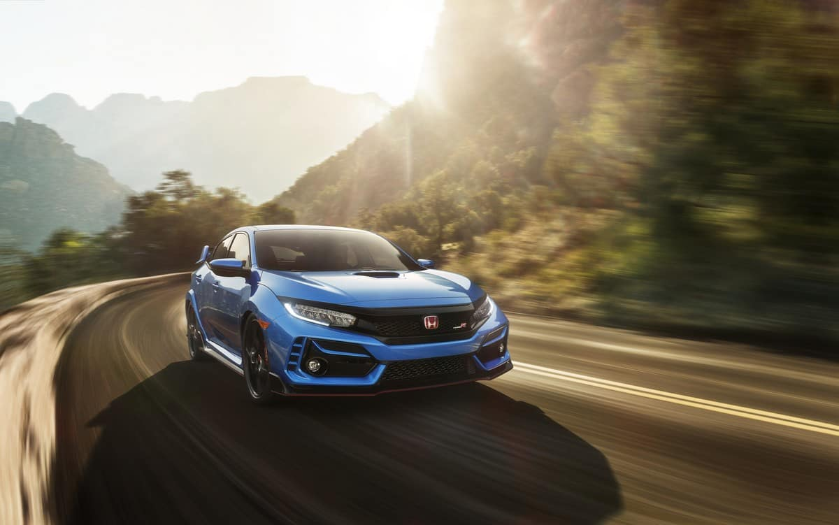 Blue 2020 Honda Civic Type R driving on mountain road