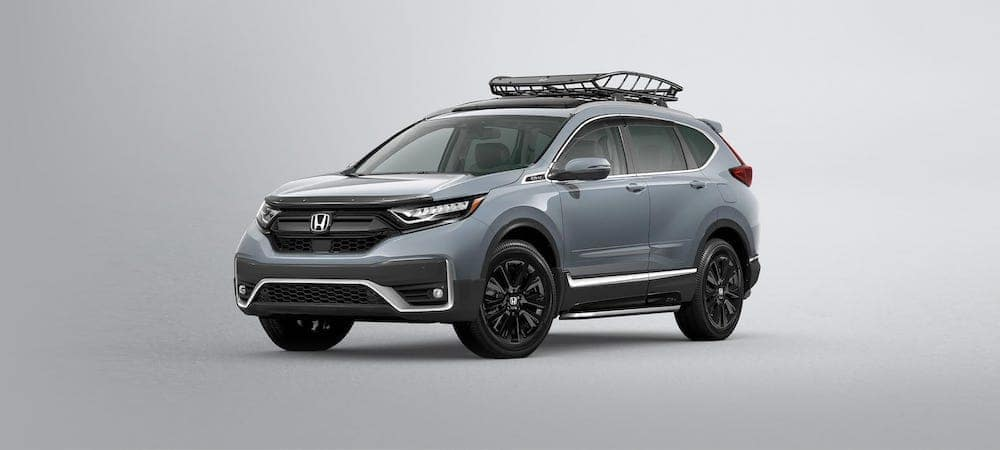Silver 2020 Honda CR-V with roof racks against gray gradient background