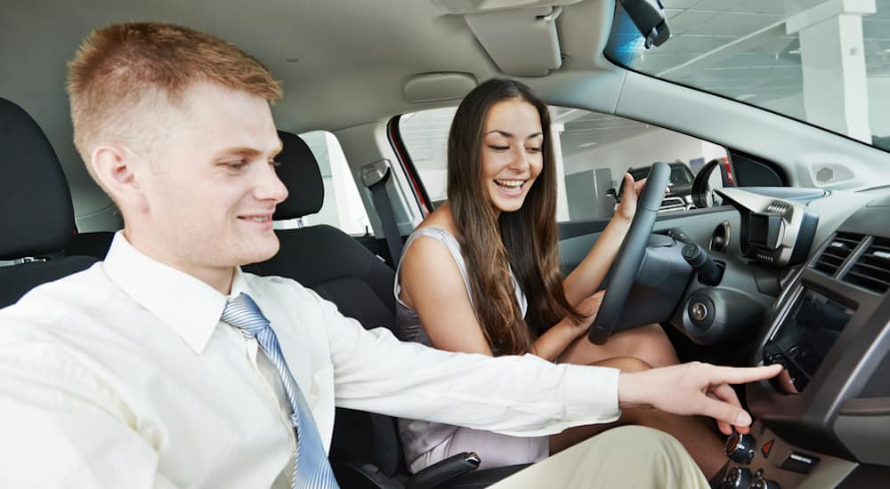 Used Car Customer Getting Features Tour in Atlanta