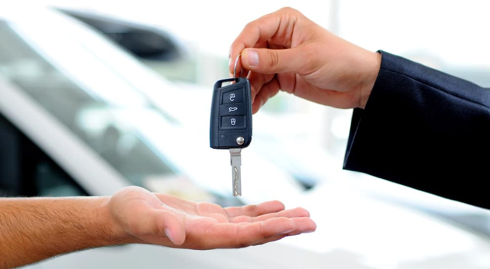 Handover of car keys in a dealership