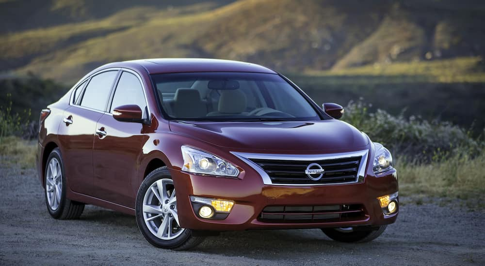 A red Nissan Altima, one of the most popular used cars for sale in Atlanta