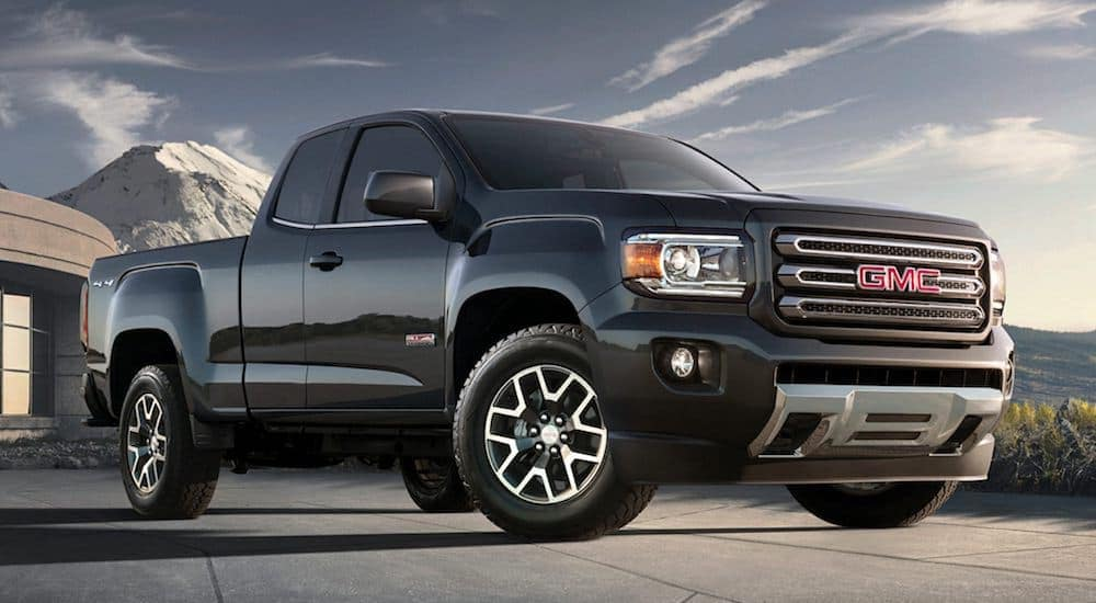 A black 2017 GMC Canyon from a used car lot in Hiram