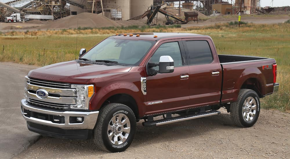 A red 2017 Ford F-250 with a powerstroke diesel engine outside a factory.
