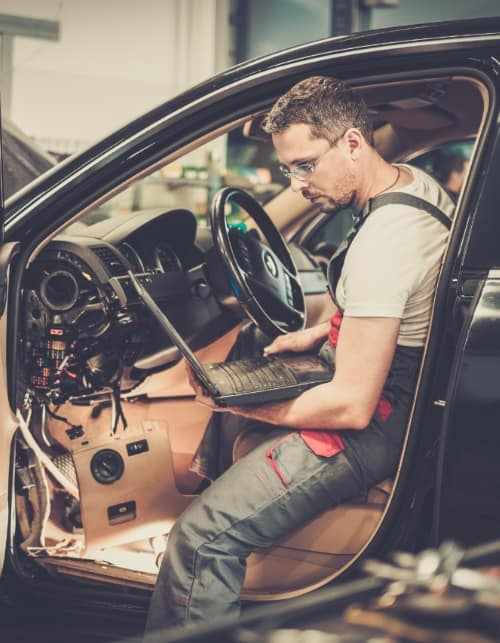 diagnosing car problems with a laptop