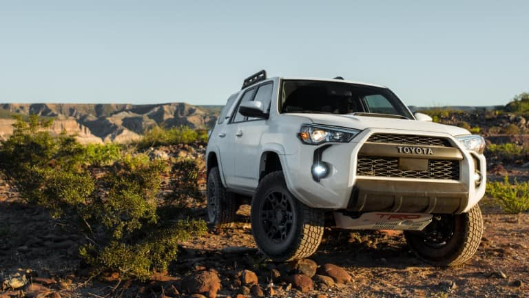 2020 Toyota 4Runner TRD Pro exterior shot with Super White paint color parked in a rough and rocky wilderness