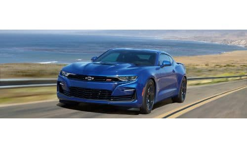 2020 Chevy Camaro exterior shot with blue paint color driving near the sea