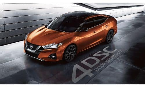 2020 Nissan Maxima exterior overhead shot with dark orange paint color in an underground tunnel