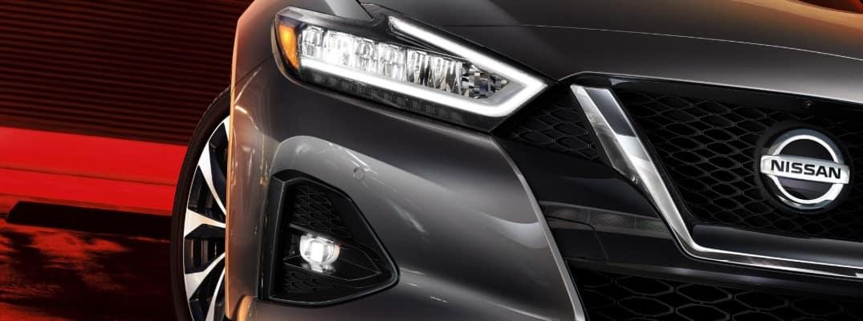 2020 Nissan Maxima sedan exterior closeup shot of headlights and grille