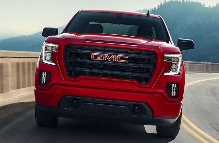 2020 GMC Sierra 1500 with red paint color exterior front shot of grille, badging, and headlights
