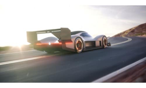 Volkswagen I.D R Pikes Peak concept electric racing car exterior rear shot of bumper and spoiler with highway sun flare