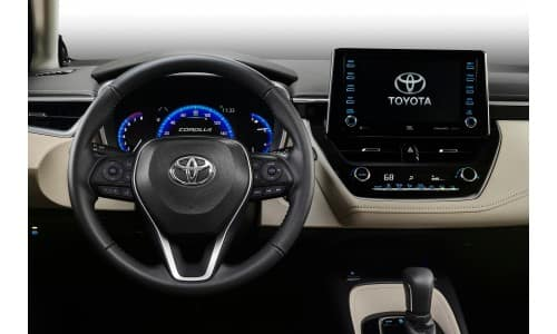 2020 Toyota Corolla interior shot closeup of steering wheel, transmission knob, and infotainment display