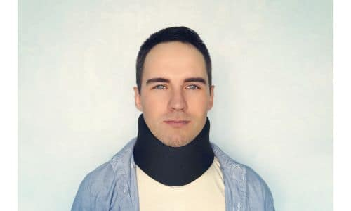 a white man in a neck brace
