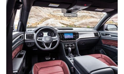 2020 Volkswagen Atlas Cross Sport interior shot of front seating red leather upholstery and dashboard design and layout