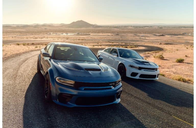 2020 Dodge Charger SRT Hellcat Widebody and Scatpack Widebody models driving down a desert road