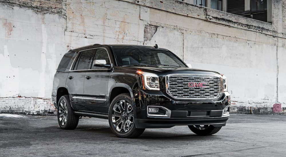 Black 2018 GMC Yukon Denali under a concrete bridge