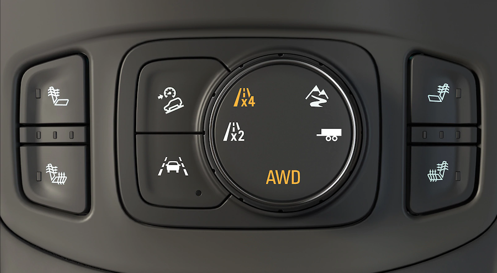 Closeup of 2019 GMC Terrain traction control buttons and knobs