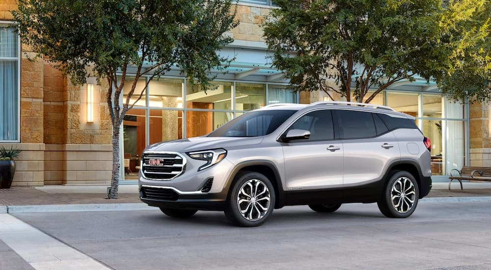 Silver 2019 GMC Terrain on tree lined road