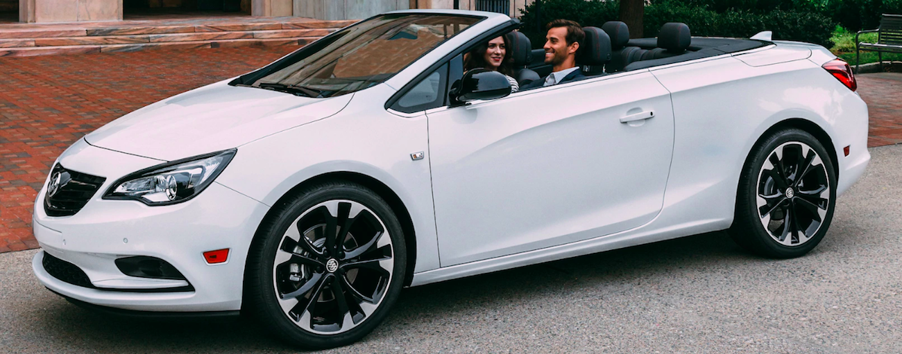 Man driving white 2019 Buick Cascada with woman in passenger seat