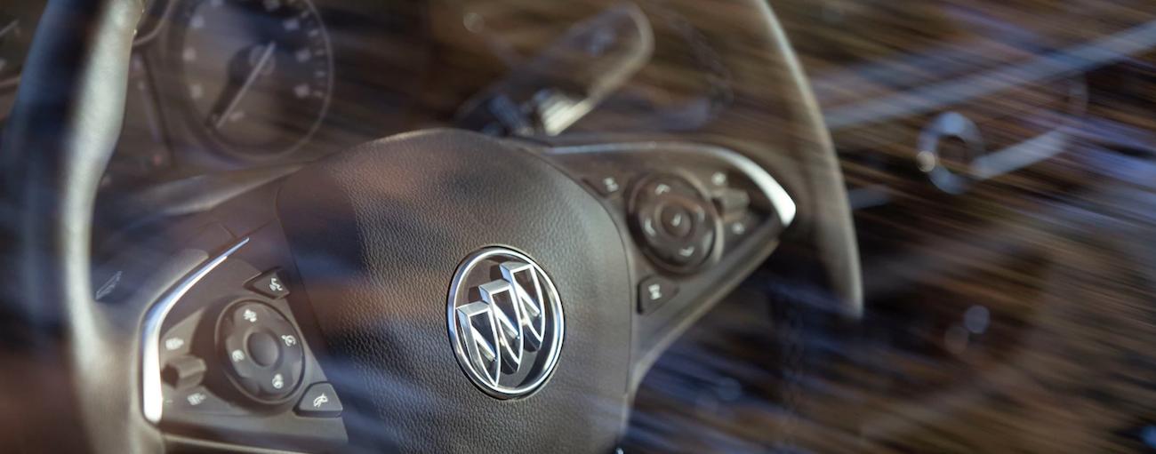 Closeup of 2019 Buick Regal steering wheel through glass