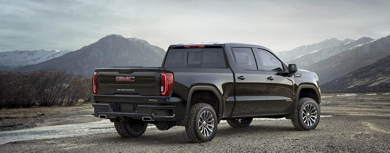A black 2019 GMC Sierra 1500 sits triumphantly overlooking a mountain pass