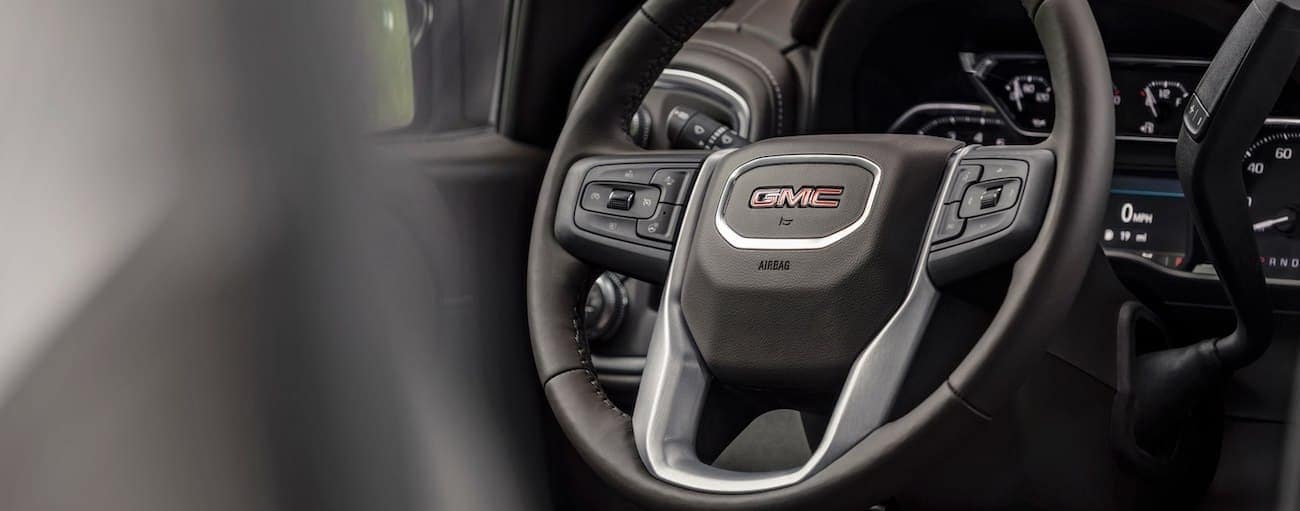 Closeup of 2019 GMC Sierra 1500 wheel and dash