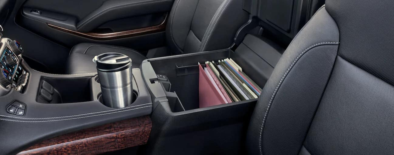 Center console of 2019 GMC Yukon filled with files