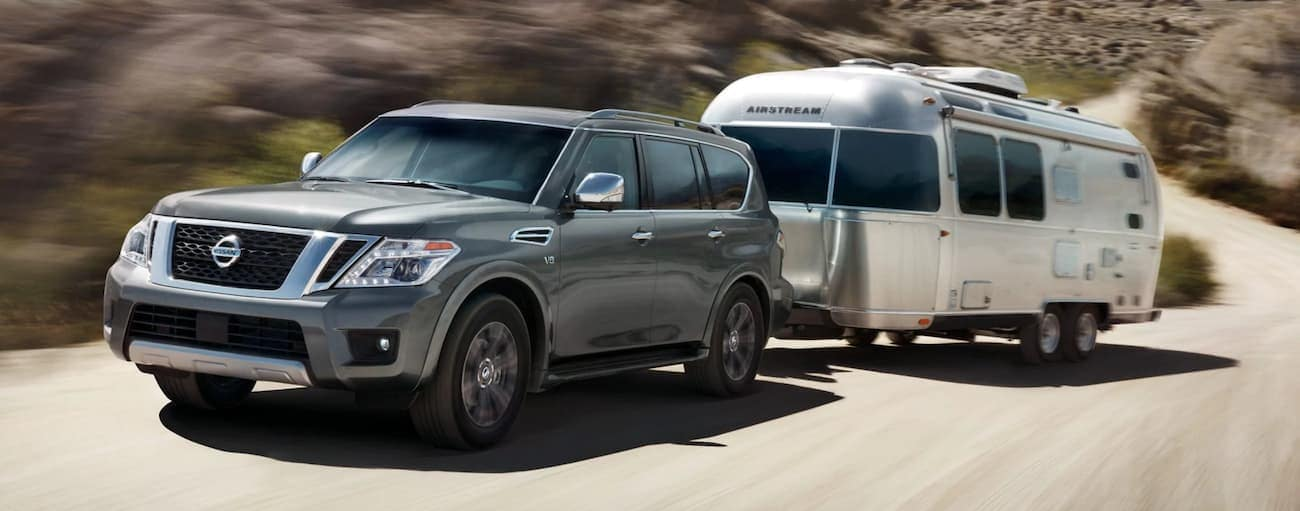 Gray 2019 Nissan Armada towing airstream camper in desert