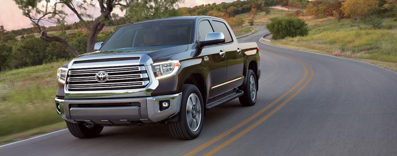 Black 2019 Toyota Tundra driving on windy road