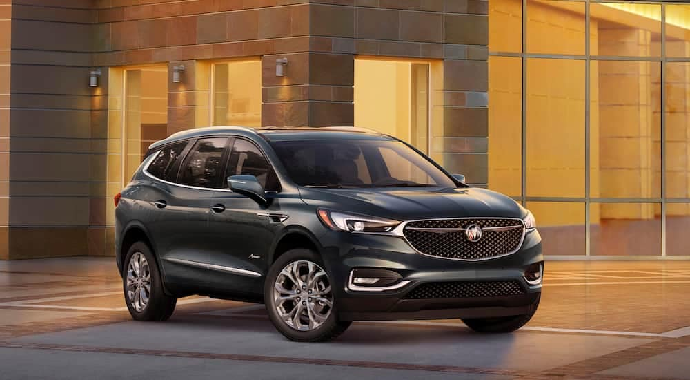 A black 2019 Buick Envision parked outside a upscale Roswell home